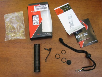 Box, instructions, extra o-rings, tailcap, and lanyard